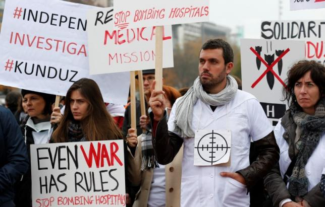 Staff of MSF demonstrates one month after the US bombing of their charity-run hospital in Kunduz in Afghanistan in Geneva